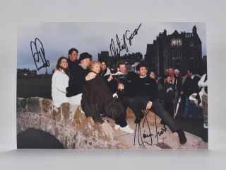 Photograph signed Dunhill cup victory. Ernie Ells, David, Frost, Retief, Goosen.